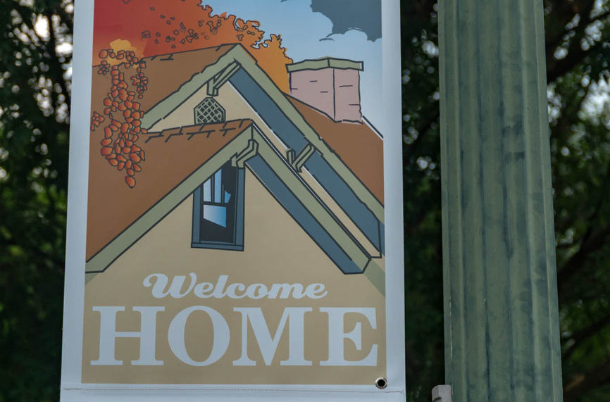Street banners add welcoming ambience to a streetscape and can be important identifiers and wayfinding systems. I used illustrations on this series of banners. They were drawn from photos that I made walking the streets of this neighborhood, so  that actual local buildings were featured.