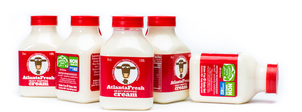 "Maybe the cutest AtlantaFresh package, the ""shorty"" as it was promoted, made it into the new milk line, even though cream had been packaged with this label since 2008. Following the color coding system, since whole milk was bright red, cream was a rich dark red. Shelf presence was built in."