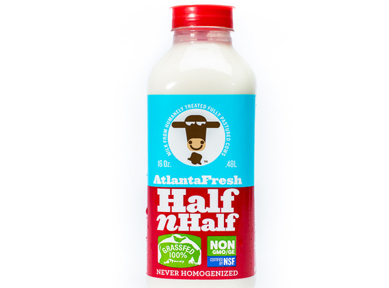 When extending the yogurt packaging to AtlantaFresh's new milk product line, the logical system of fate level color coding was applied: with half and half the natural move was to use the nonfat and the whole milk colors, and split the label.