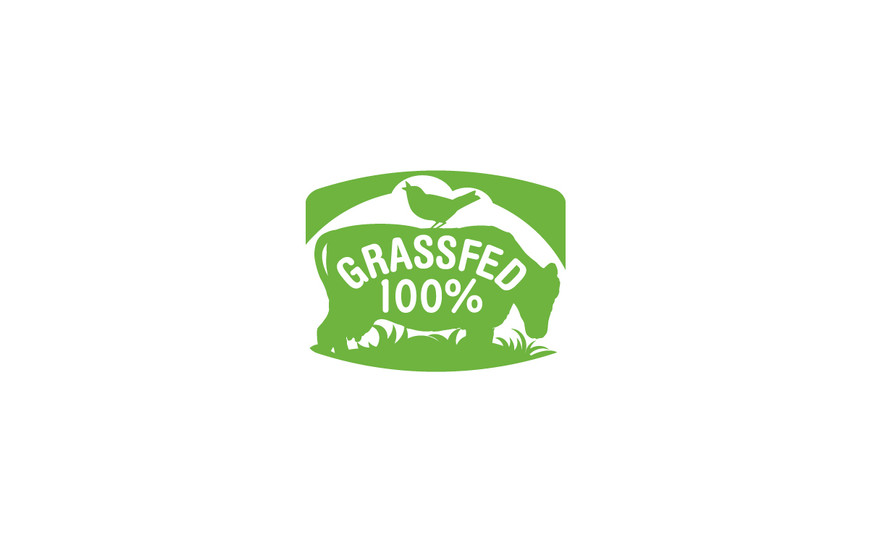 To create completely original art for a grass-fed seal that would be used on multiple brands, a plastic cow model was photographed, a bird on a telephone wire was photographed. The photos were traced in Illustrator and shaped and composed with background and type.