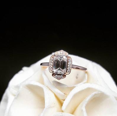 A STUNNING emerald cut engagement ring