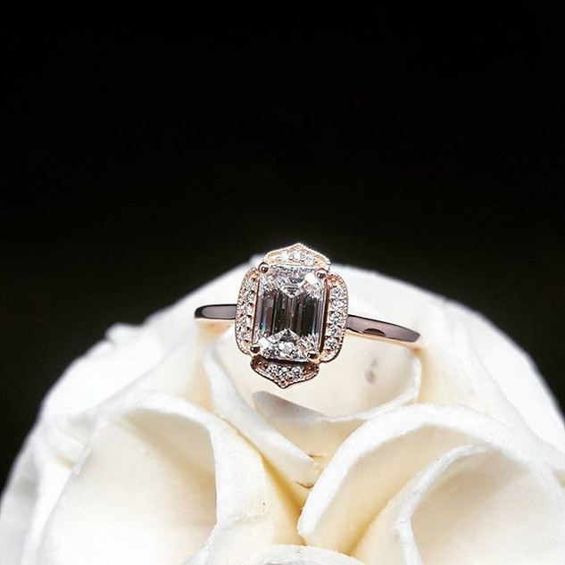 A STUNNING emerald cut engagement ring