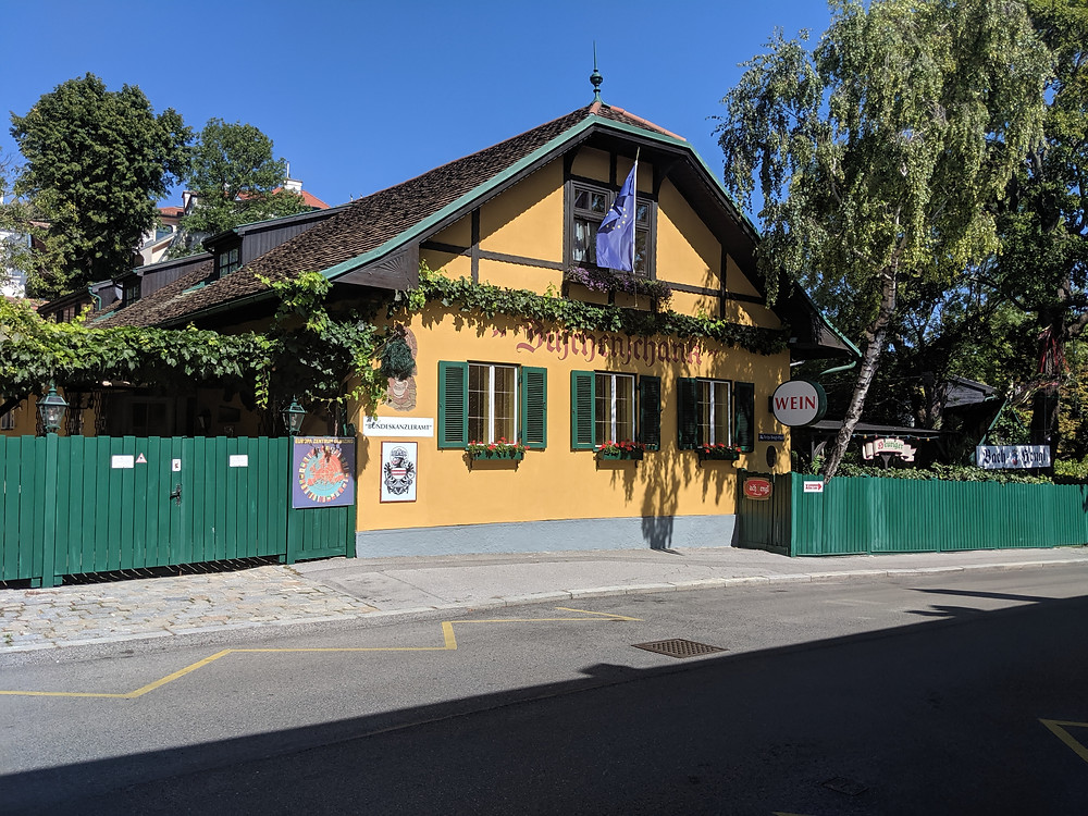 Exterior photo of a traditional wine tavern in Grinzing wine village north of Vienna
