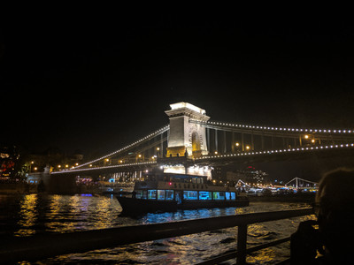 Bridge over Danube river lit up at night.