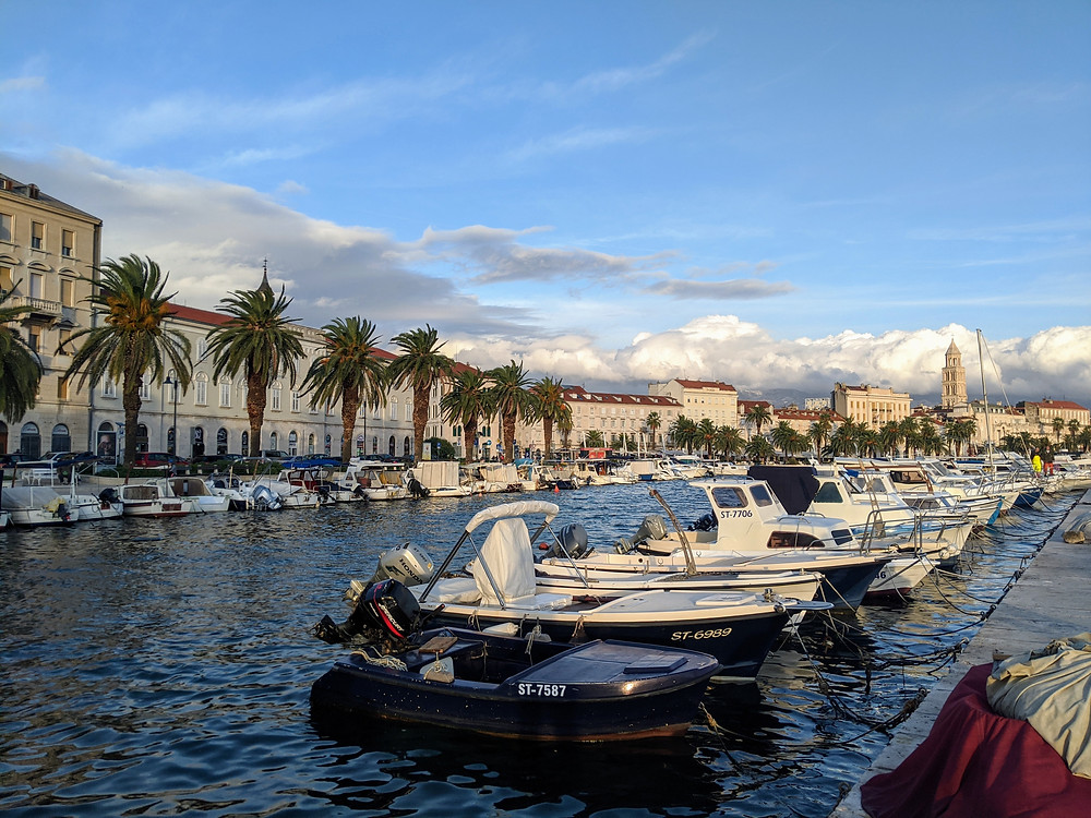 fishing boats in a harbor on a sunny day in Split, Croatia