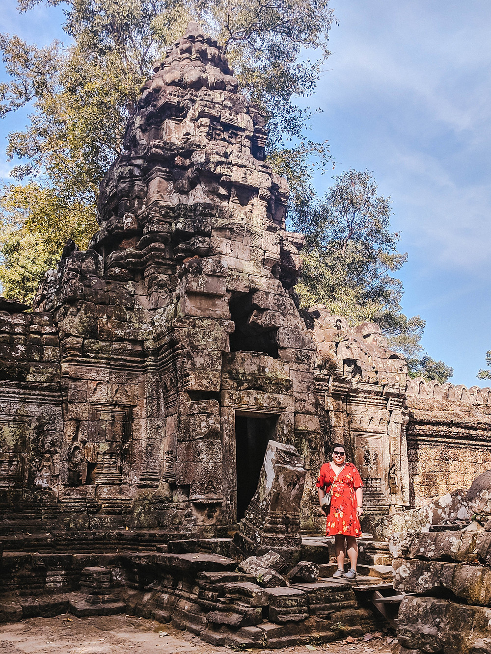 image of a young lady in a red dress in front of a template in Cambodia