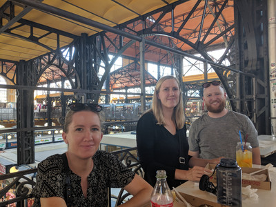 Eddie, Megan, and friends eating lunch in the market.