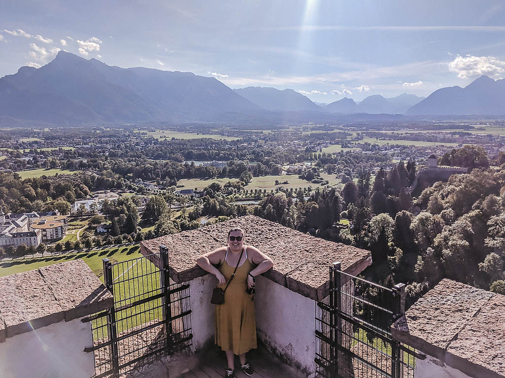 young girl in the sunshine with a mountain view behind