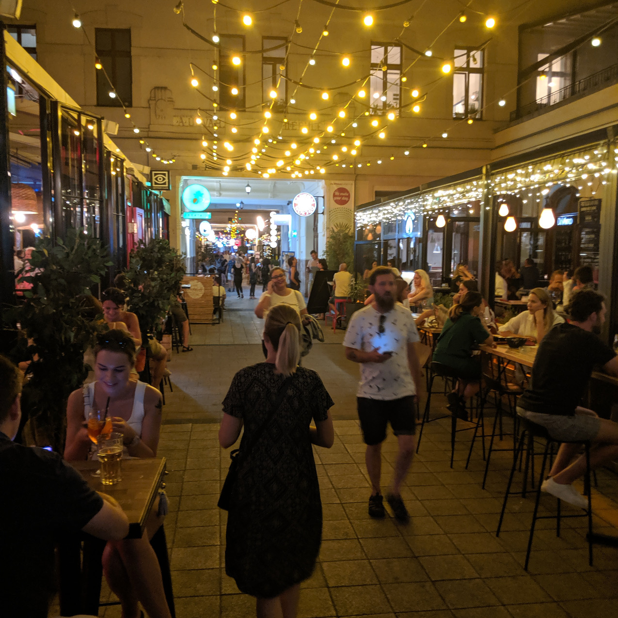 Photo down the popular bar street in Budapest. Party lights and outdoor seating everywhere.