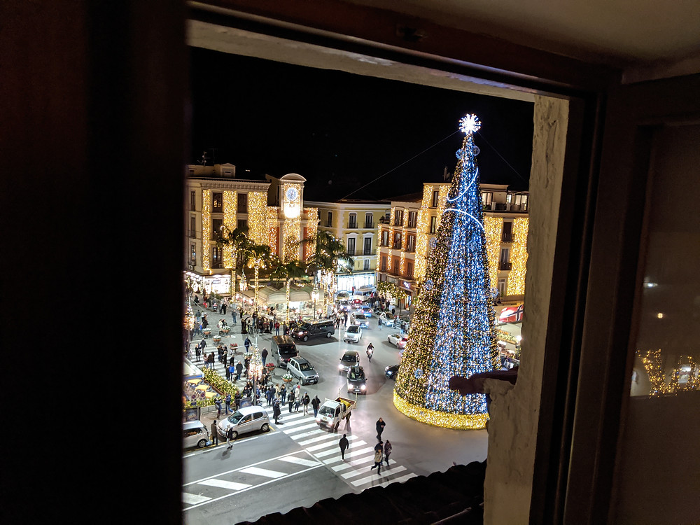 View from 5th floor window with Christmas tree and lights in the public square below