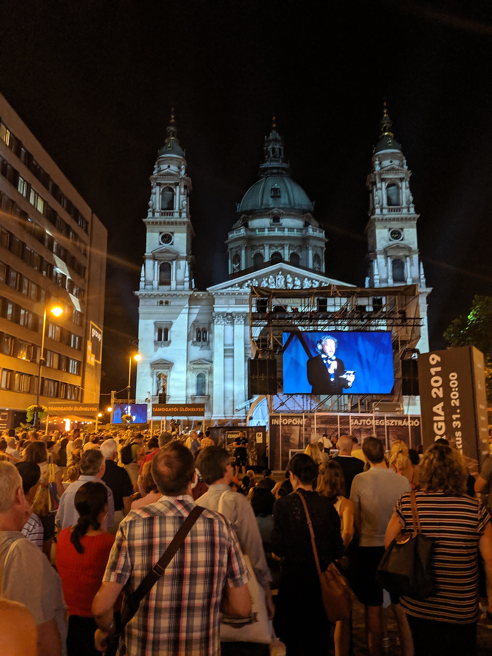 St. Stephen's Basilica at night with concert in the square.