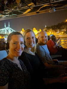 Eddie, Megan, and Megan's sister on a night time boat ride of the Danube.