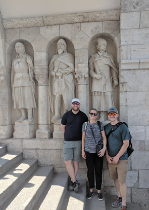 Eddie and his Brother In-law and Sister In-law in front of some statues in the Fisherman's Bastion