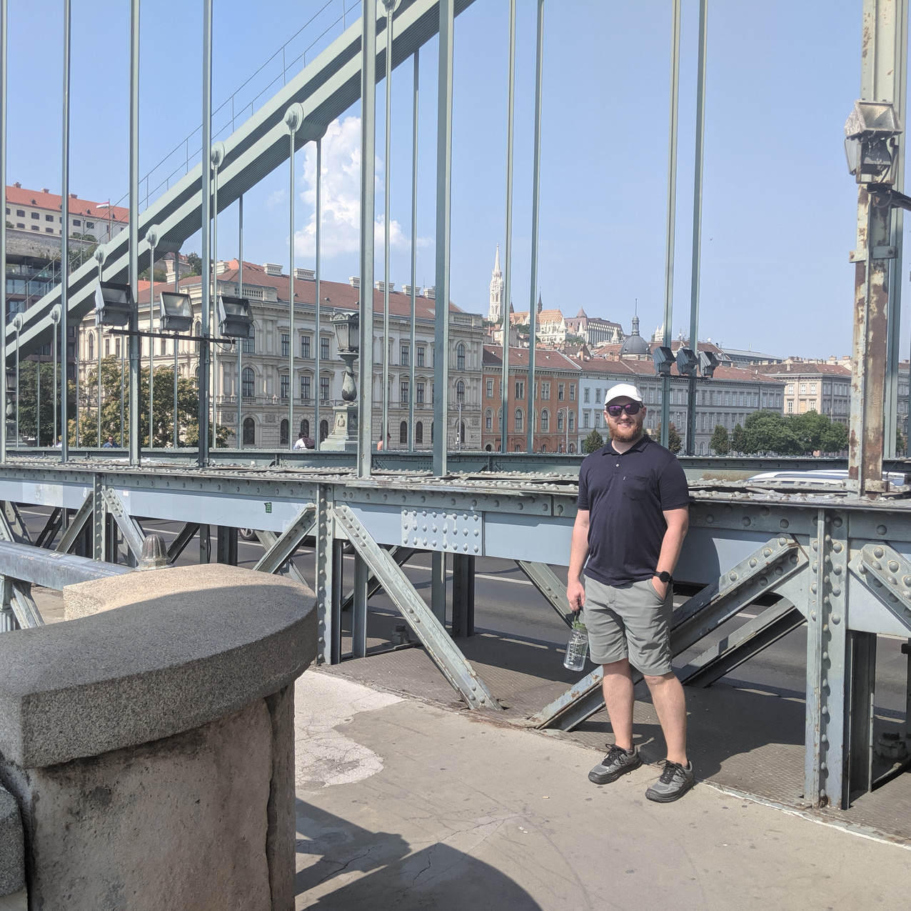 Eddie on a bridge crossing the Danube during the day.