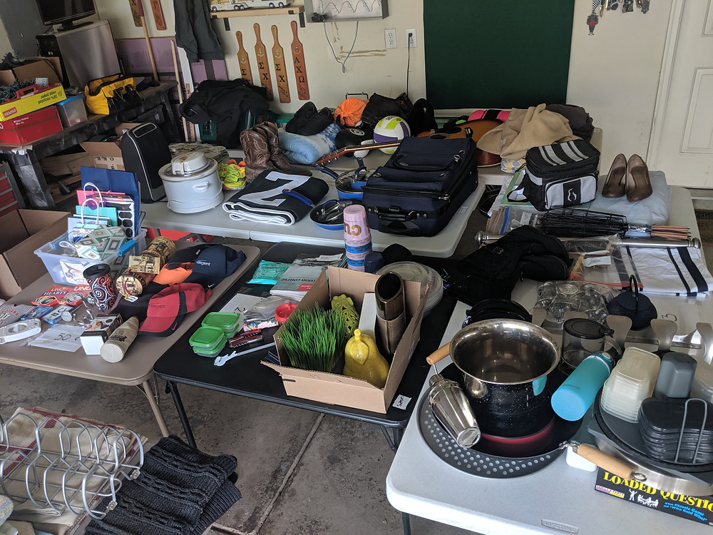 A garage sale full of personal possessions, ready to be sold to enable a full time travel lifestyle