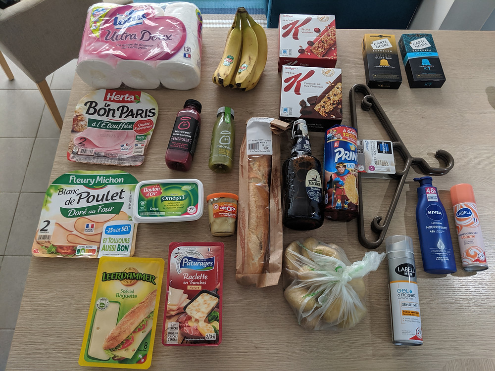 Arial photo of random products purchased at the grocery store. First grocery trip while we were in Lyon, France.
