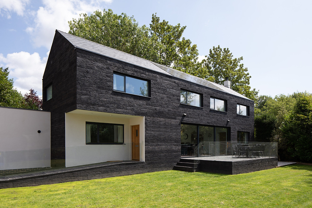 modern self build home with black composite timber cladding