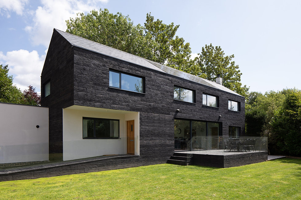 Modern new build house with black, charred timber cladding and open plan kitchen