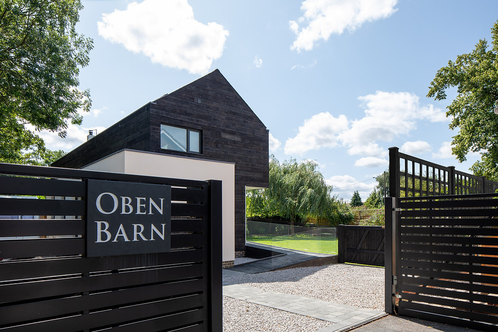 front entrance and gate to modern self build family home in Wiltshire