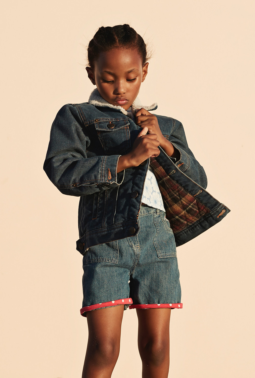 black child model wearing denim jacket and shorts