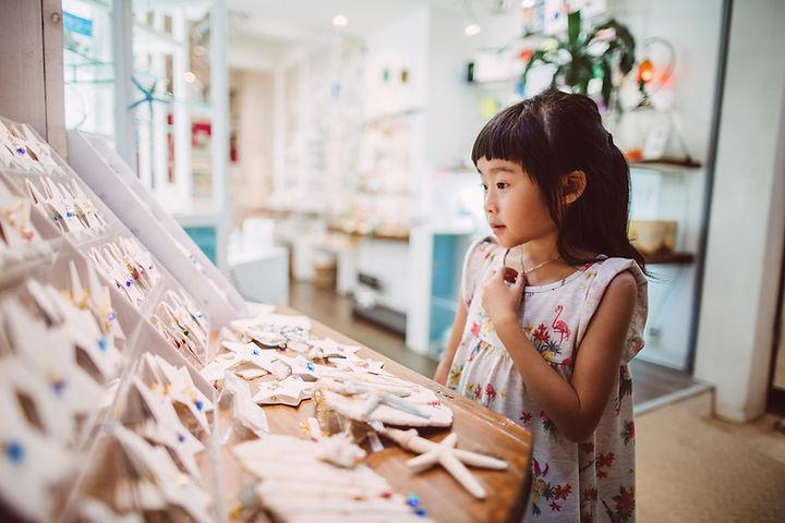 A girl looking at souvenirs.pg