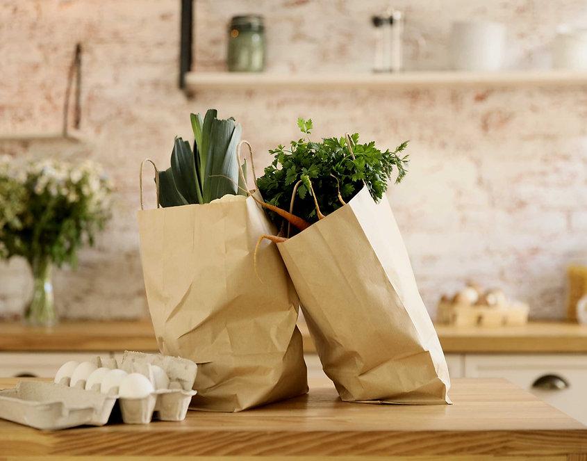 Groenten in papieren zakken