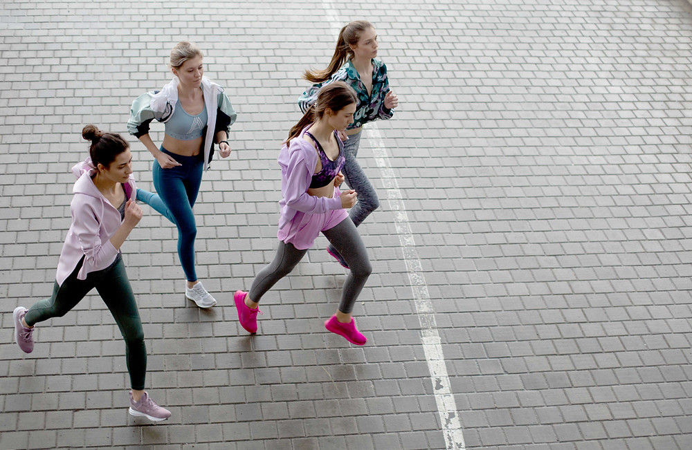 Group of friends running