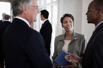 Corporate meeting attendees talking