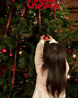 Girl Hanging Up Ornaments