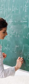 Female Teacher during a Math Class