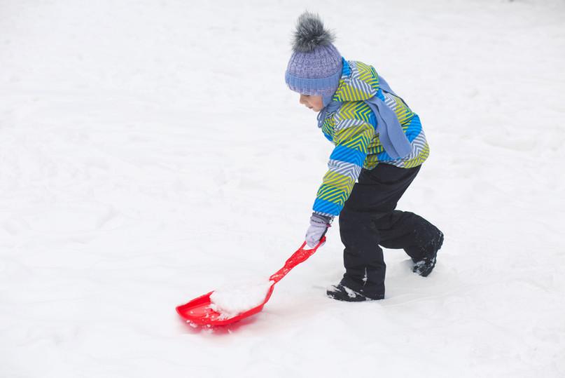 Girl Shoveling Snow