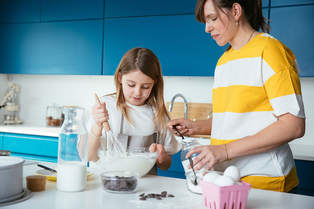 Involve kids in some fun activity, like baking cake, to help them fight boredom.