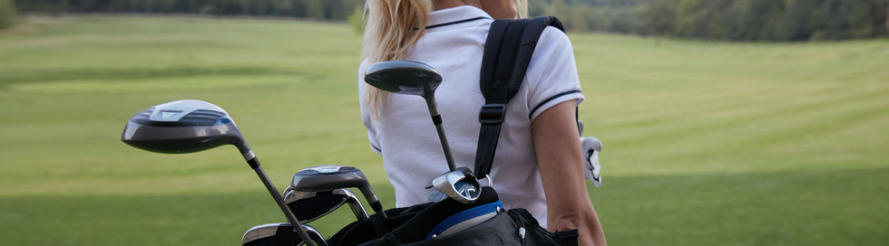 Female Golfer with Clubs