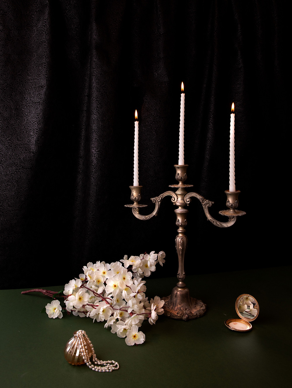 Candleabra with 3 Candles, plus flowers and time piece and ornament.