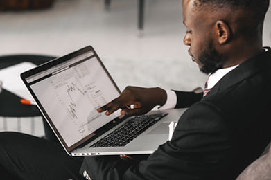 A man pointing at his laptop screen