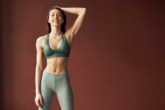 éanè Clothing Woman wearing activewear leggings & sports bra