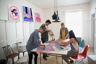 Room of people in a workshop making posters