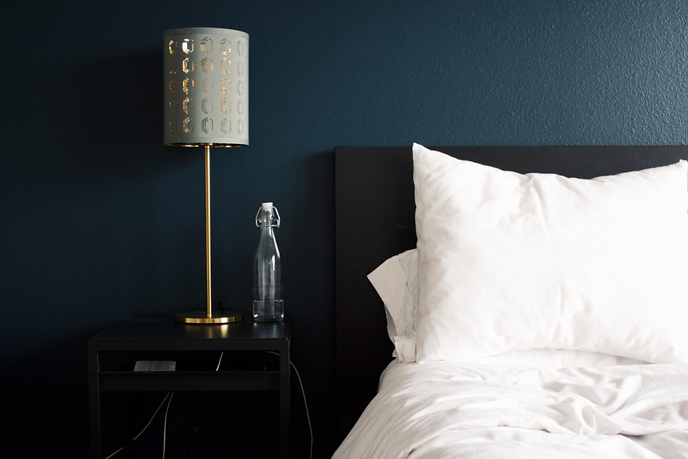 Cozy bed and nightstand with Peninsula Family Coaching