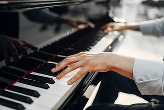 Fingers Playing Piano Keys