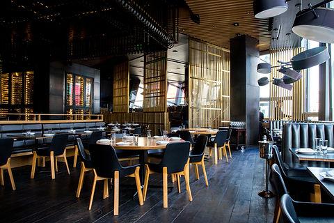 Interior of restaurant in dark colour scheme by Phoenix Decorators Worcester 2021