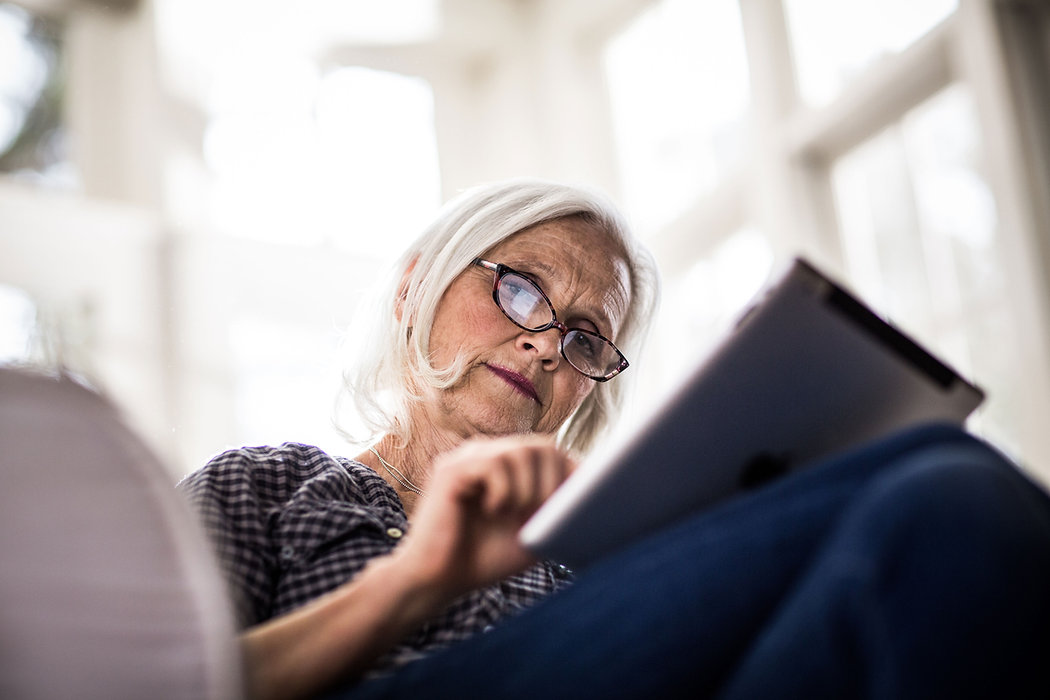 A woman reading on her tablet device