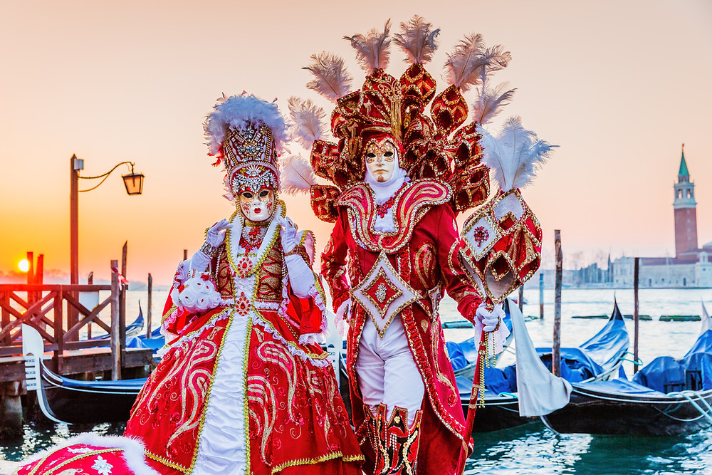 a couple in costume during Venice Carnival