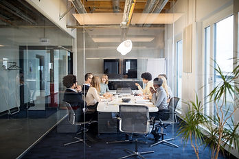 People sitting at a table in a conference room