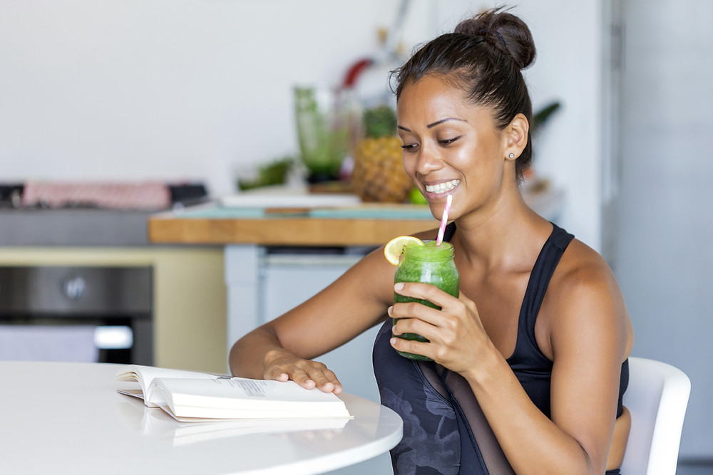 Lady drinking a smoothie to enhance her capabilities