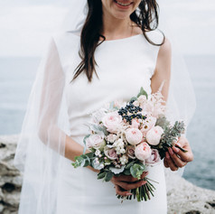 Bride with bouquet of fresh flowers