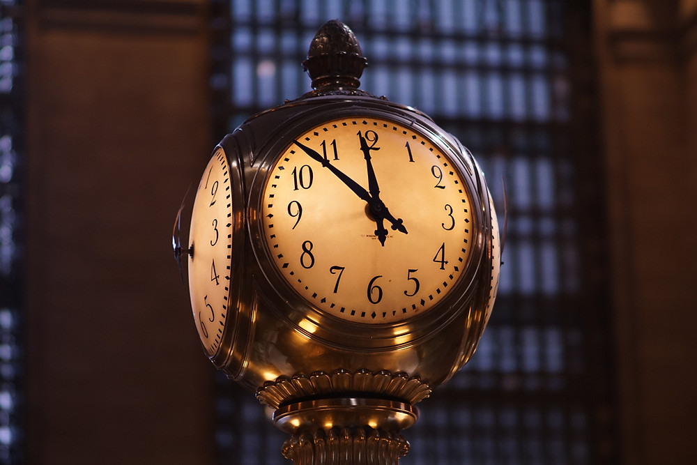 Clock illuminated in a train station