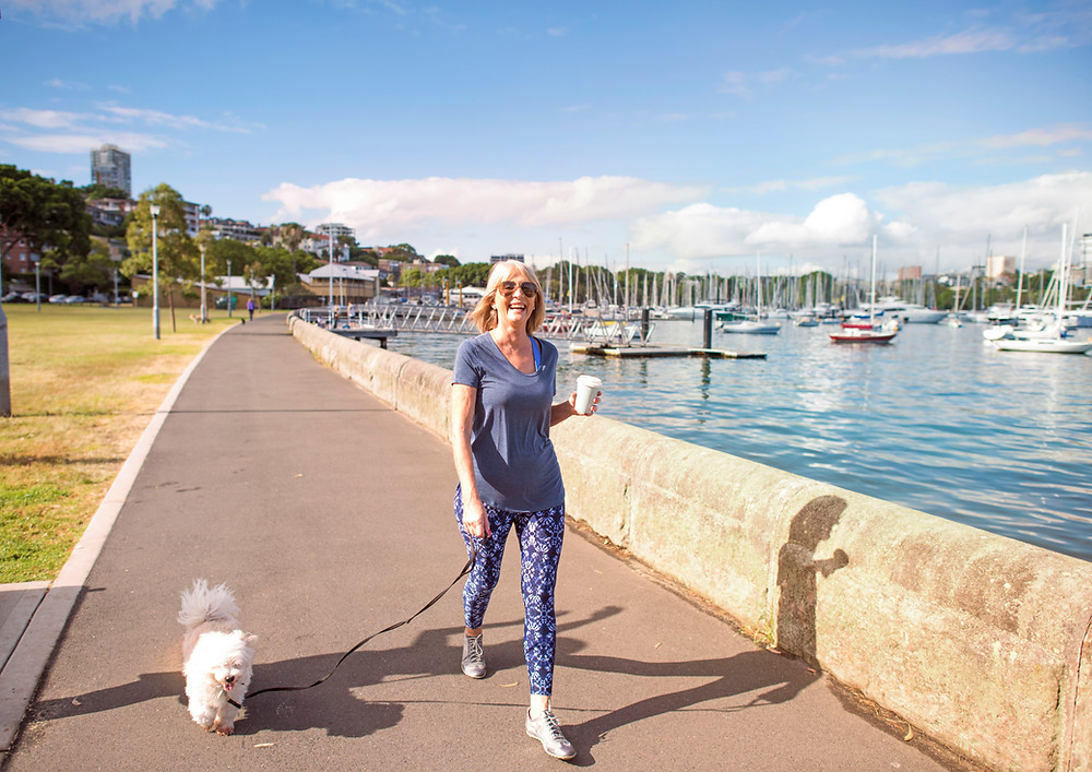 Woman Walking Dog Wellness and Prevention Chiropractic Dr Nathan Jenner Chiropractor Prahran Windsor 3181
