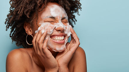 Woman washing with natural skincare