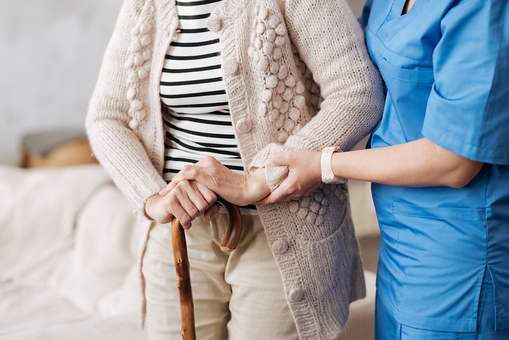 A nurse caring for an elderly person