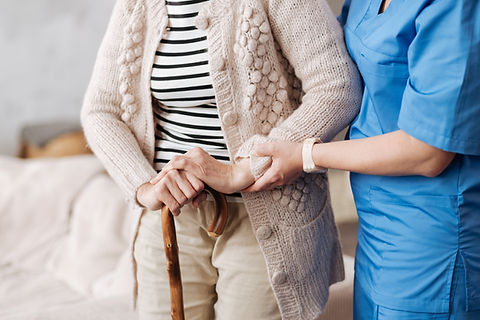 Senior resident with caregiver assiting at residential care home